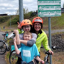 Lou and her two children riding their bikes on the 30 Mile Loop Trail in Portland.